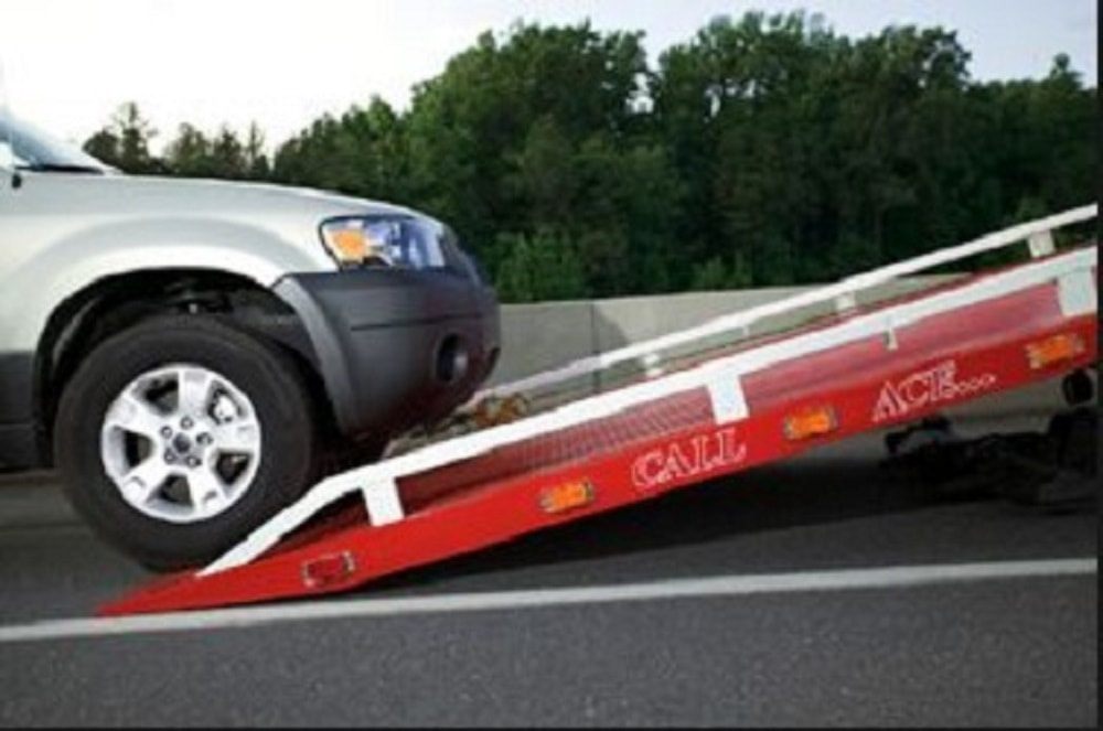 a car at the back of a tow truck